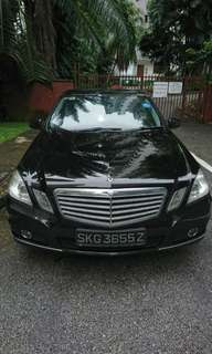 Black Mercedes E250 for rent.