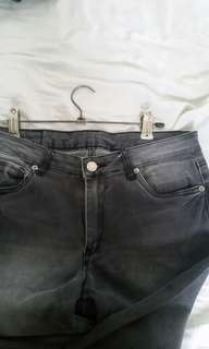 Gray and black mid waist stretchable pants / jeans