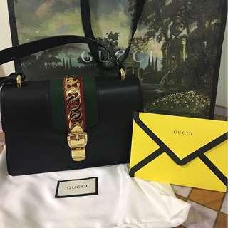 Gucci Sylvie medium chain-embellished leather shoulder bag