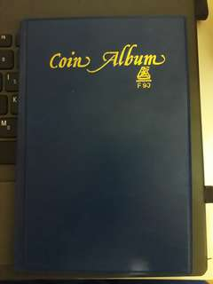 Coin Album with Singapore Coins