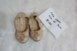 Gold doll shoes