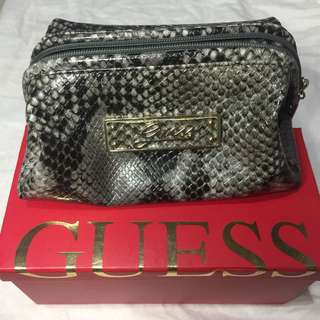 Guess clutch snake pattern
