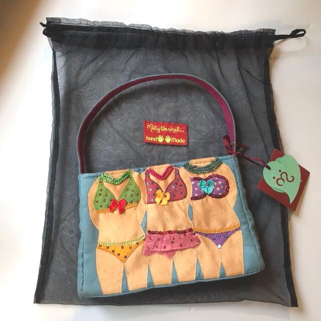 Mety Darmali bikini girls blue suede bag