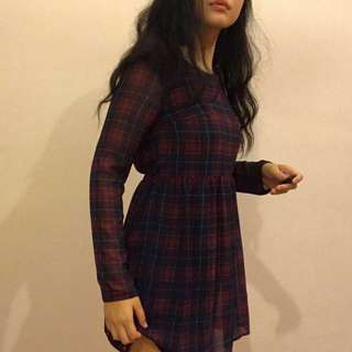 Checkered dress with cut design at the back