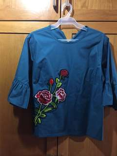 Blue blouse with embroidery