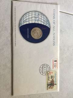 First day cover with coin