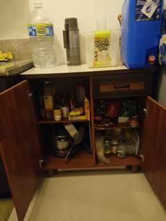 Kitchen cabinet and coffee maker and slow cooker