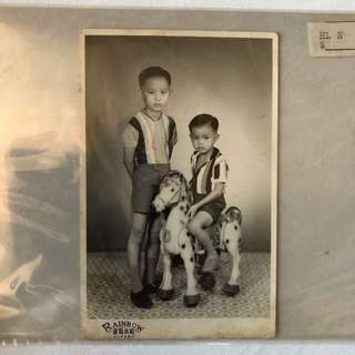 Vintage Old Photo - old Black & White photograph showing Siblings with a wooden horse taken in a studio (13 by 9 cm)