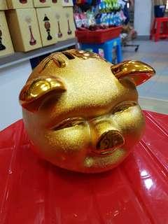 Golden pig coin holder ceramic
