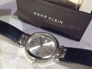 Authentic Anne Klein silver watch with black leather strap