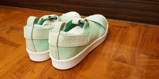 Adidas Slip ons in Mint Green US 5. Brand new