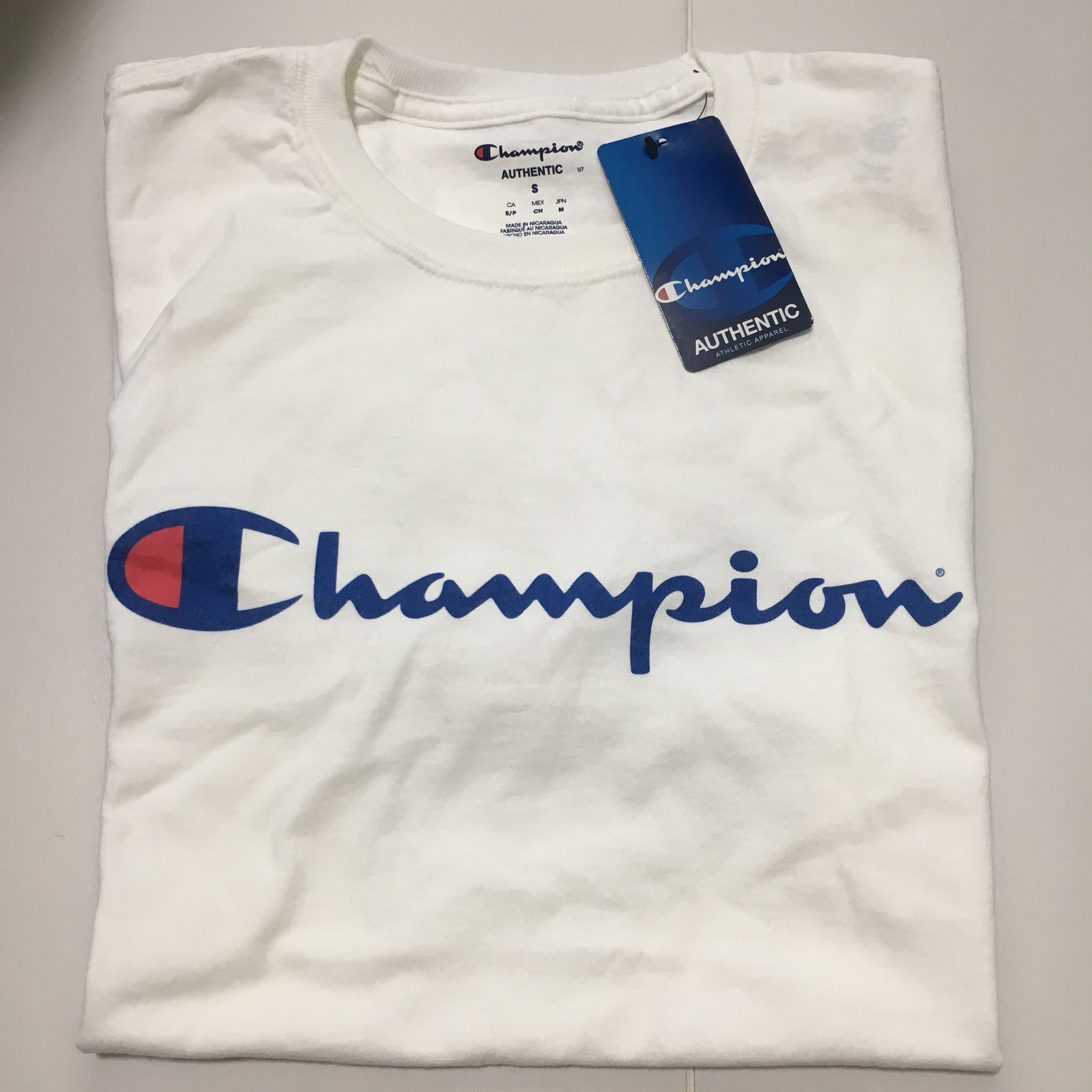 3a8ecaec [Instock] Champion T Shirts, Men's Fashion, Clothes, Tops on Carousell