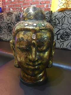 Antique buddha head with gold foil