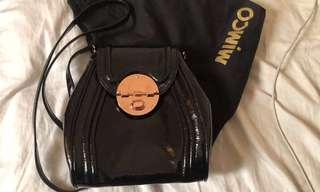 Mimco black offbeat hip sling bag turn lock opening