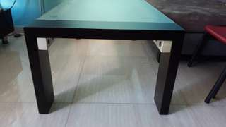 Frosted glass top with solid wood sides and legs. Cond: 7/10