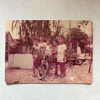 Vintage Old Photo - Old photograph showing kids in Kampong Village