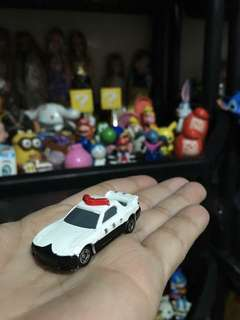 Small white police car
