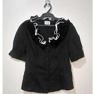 Black blouse with ruffles on the neckline