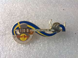 Hard Rock Cafe Pins - STOCKHOLM HOT & RARE 2002 AXE GUITAR WITH VIKING HELMET & FLAG COLORED RIBBON!