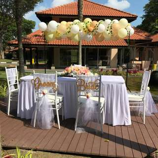 Wedding solomnmization table chairs and balloon deco