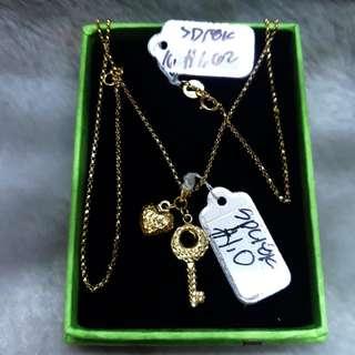 Necklace w/ locket and key pendant