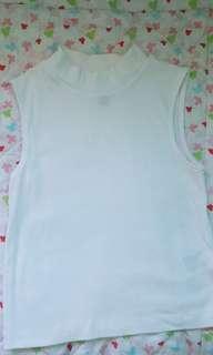 White turtleneck sleeveless top