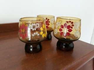 set of 3 footed vintage amber floral glasses