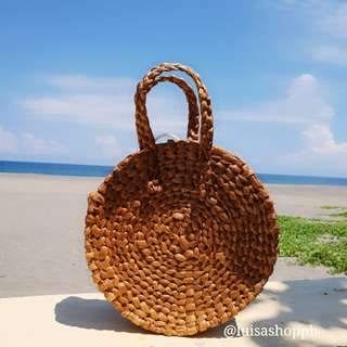 Round native bag (handheld)