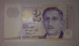 Two Dollars Singapore note with nice serial number.