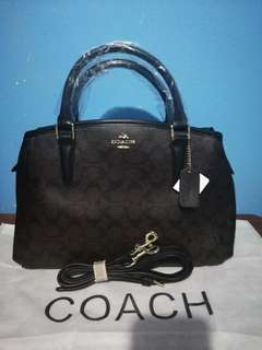 COACH WITH SLING