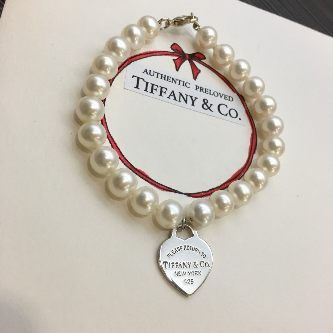 8559875eb73d3 Excellent Authentic Tiffany & Co. Return To Tiffany Pearl Silver ...