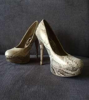 Brash snakeskin heels