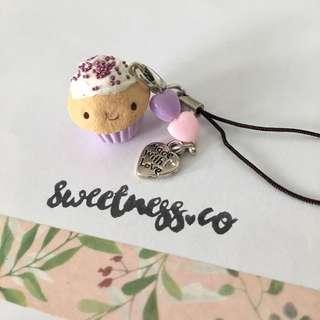 Handmade smiley cupcake cellphone strap