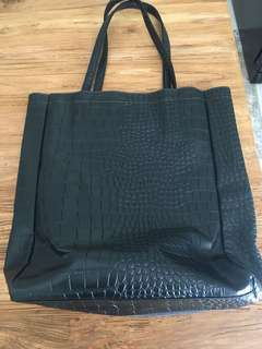Leather and suede black bag