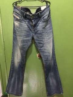 DIESEL zatiny jeans  size 31 fits 33