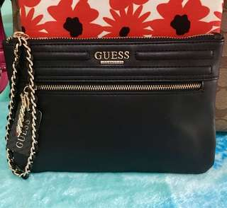 GUESS large wristlet.💯 Original po hnd lng naisama ang gift receipt.Money back guarnty if proven Fake po.or if you have doubt dont buy nlng po..thank you😊
