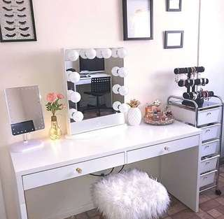 Vanity table and frameless mirror