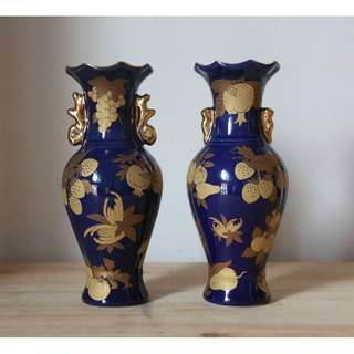 Dark blue vases with golden fruit patterns