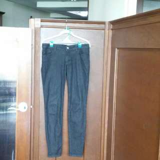 FOLDED AND HUNG LOW-RISE JEANS