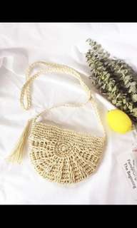 Handmade straw crochet sling bag - half moon shaped