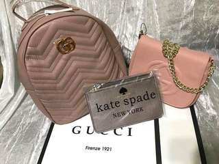 Pink gucci backpack and sling bag