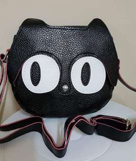 cat head sling bag