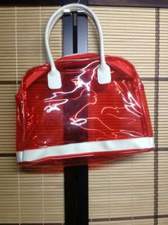 RED TRANSPARENT HANDBAG NEW AND STORED