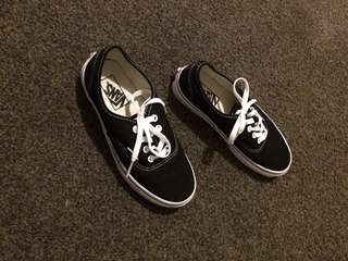 Black and white vans, female.