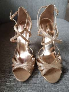 Call it Spring rosegold high heels sandals.