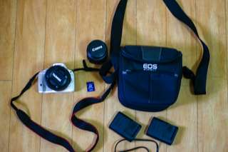 Canon EOS 100D (with 18-200 and 18-55mm lens)