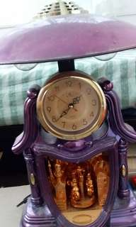 Lamp with clock