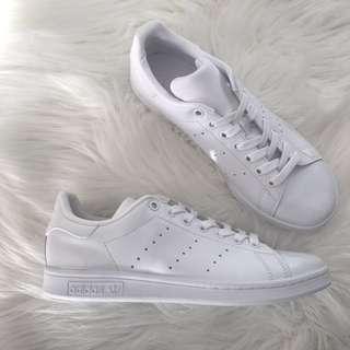 All white Adidas Stan Smiths