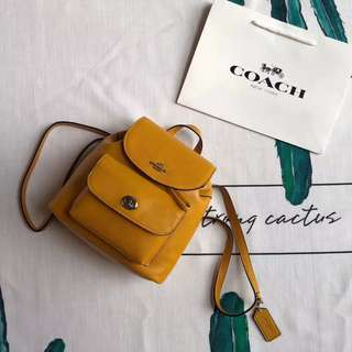 Coach Mini Billie Backpack in pebble leather - mustard yellow