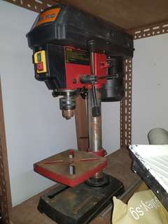 Drilling machine with stand.